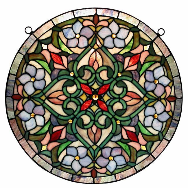 Featuring splendid colors and a beautifully balanced shape, this luxurious Tiffany stained glass window hanging allows you to enjoy the beauty stained glass provides without replacing your windows. Hanging hardware is included for your convenience.