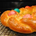 This decorative Easter bread has whole eggs baked into it! Do not cook the whole eggs, as they will bake at the same time that the bread does. The eggs can also be dyed for extra color