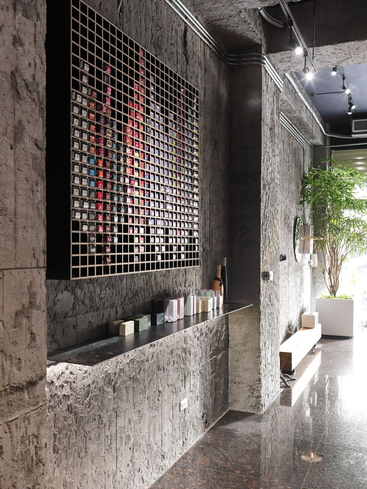 Taiwanese studio Soar Design has designed a rectangular shared table and movable mirrors to make the most of this hair salon's long space.