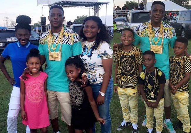 Boosie Badazz with his 4 daughters and 3 sons at an outdoor event in May 2016...