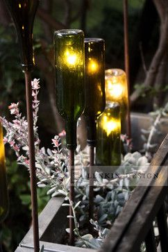 If you do go ahead with the bottle wall, adding in other bottles could help unify the garden space, I love these wine bottle lights!