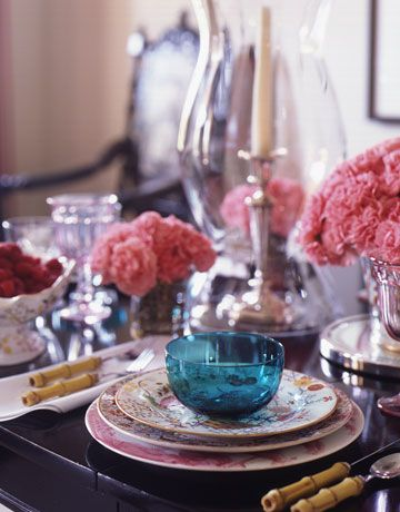 Place Setting:   Haas sets the table with a mix of antique and modern pieces. English handmade charger plates from Deborah Sears. Salad plates from Bardith, New York. Dinner plates are Antique Davenport from Hollyhock. Turquoise bowl from Evans & Gerst.