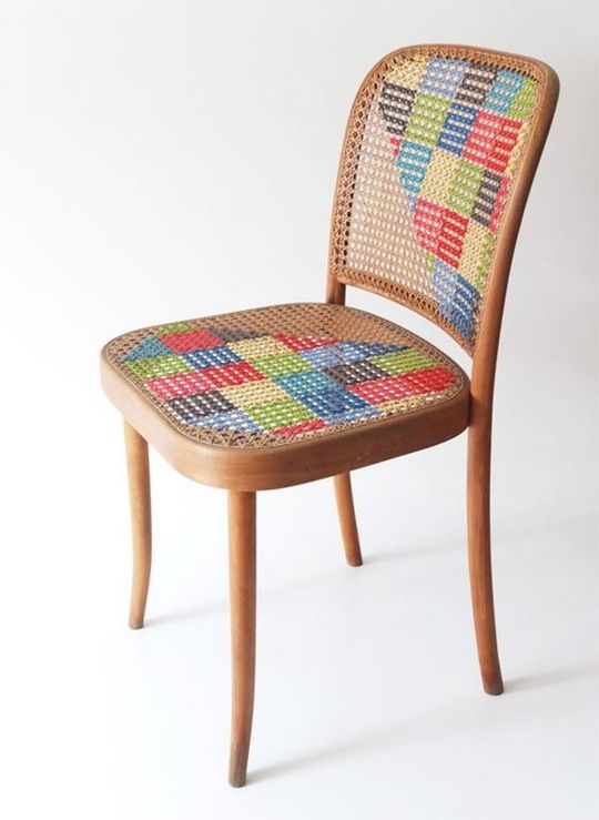 cross stitch on cane back chair