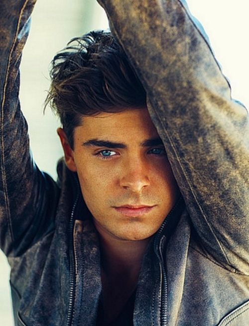 Zac Efron , a boy with brown hair and clear blue eyes , isn't he perfect ?