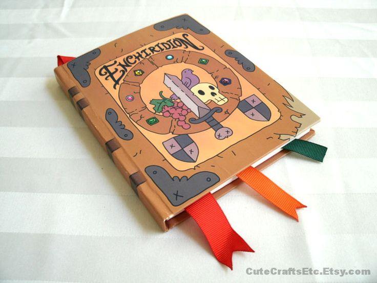 The Enchiridion - Big Adventure Time Book (PREORDER Apr.8). $30.00, via Etsy.   OH MY GLOB.