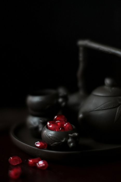 Gorgeous low key work with pomegranite seeds and a cast iron teapot
