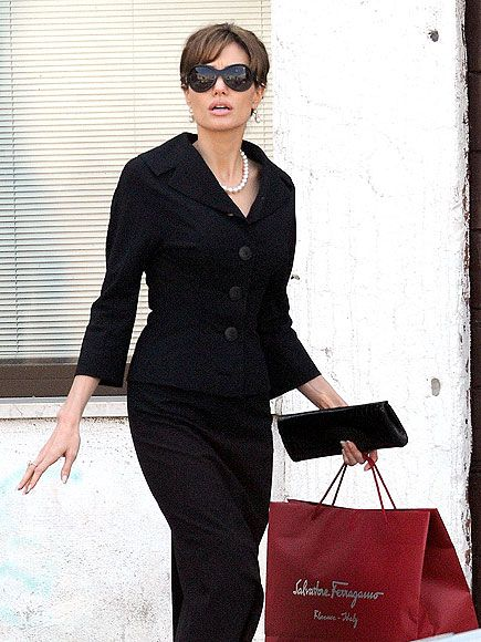 Angelina in a timeless black suit, in Venice, Italy.  (photo via people.com)