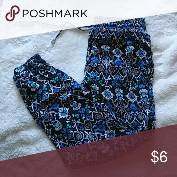 Forever 21 Jumper pants Forever 21 sz small jumper pants has a drawstring in front with elastic waistband cute flower tribal patterns. Elastic at the bottom cuffs. In used condition. Forever 21 Pants Trousers