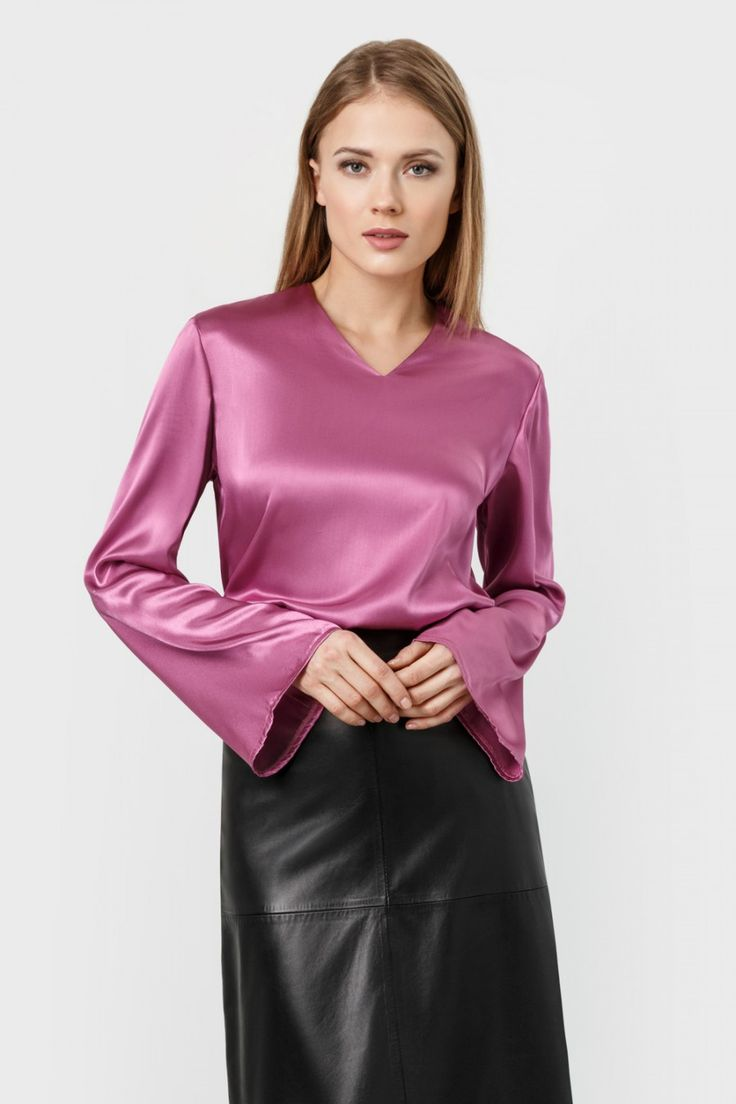 Pink satin long-sleeved T-shirt blouse and leather skirt