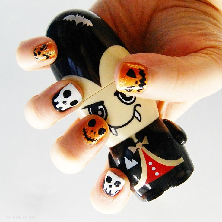 My Halloween nails this year, simple design with classic black and orange colour scheme