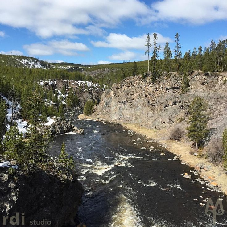 The Firehole River ends its journey through Yellowstone National Park by plunging through a narrow canyon.