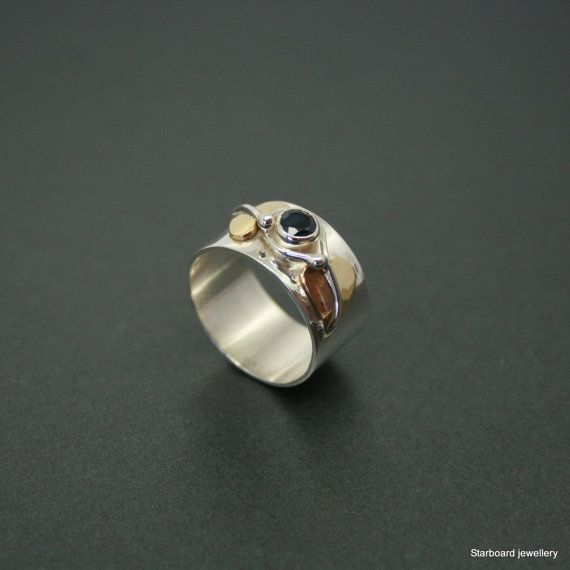 Wide silver and sapphire ring with brass by starboardjewellery