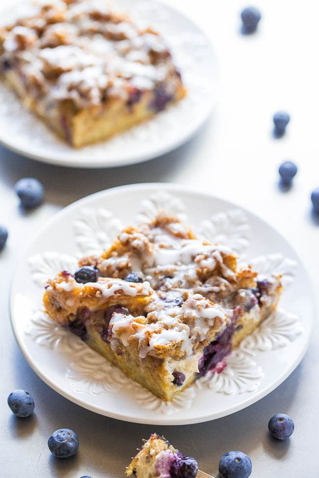 Overnight Blueberry Waffle Breakfast Bars - Blueberry waffles layered with cream cheese, blueberries, streusel, a glaze, and more for one of the BEST breakfasts ever !