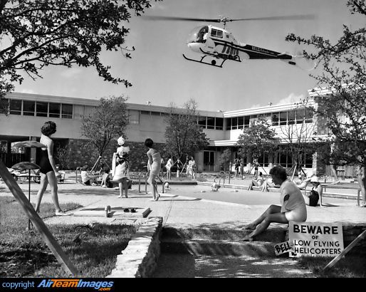 Students at the American Airlines Stewardess College near Fort Worth enjoying a swim in the pool behind the college which is good news for pilots at the nearby Bell Helicopter co.