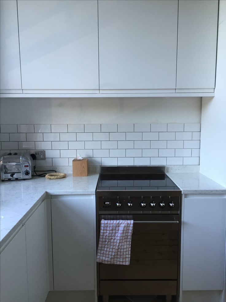 Tiling and grey grouting by Jacob