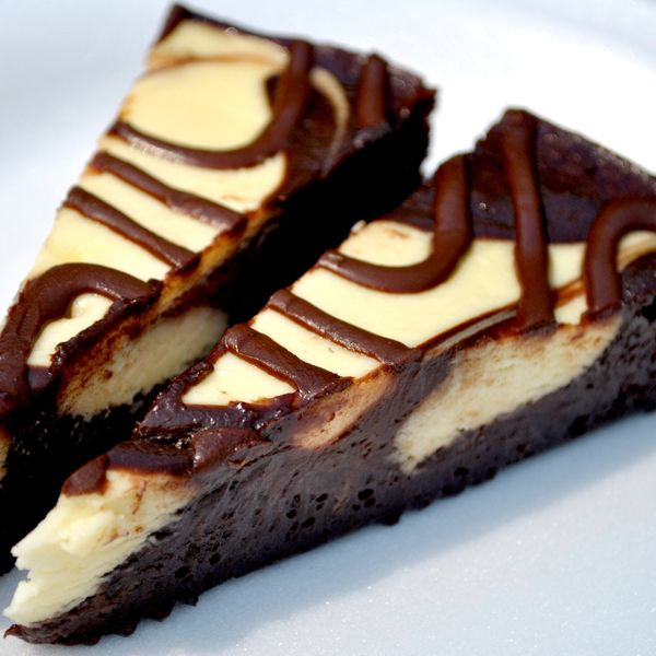 Your family will enjoy this creamy marbled pie with chocolate and vanilla fillings and a chocolate crumb crust recipe. Marble Pie with Chocolate Drizzle Recipe from Grandmothers Kitchen.