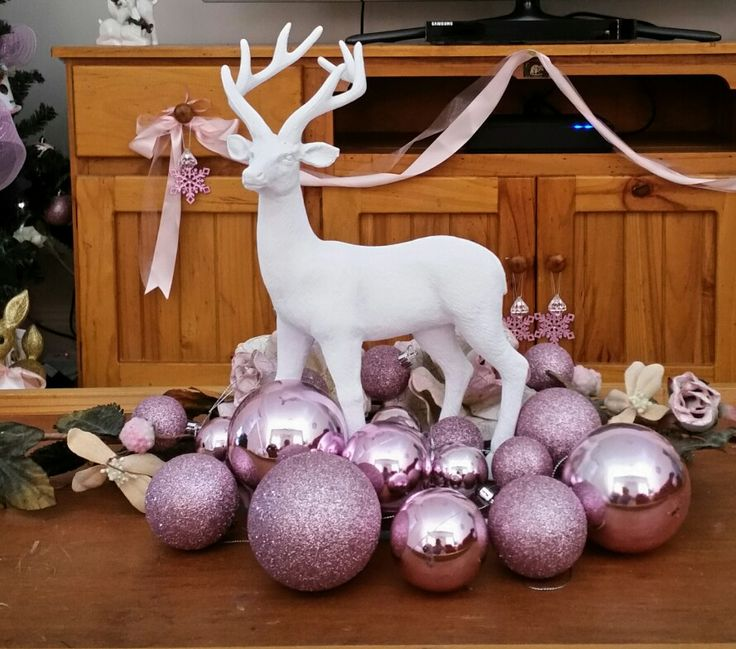 Coffee table christmas decor, gold glitter reindeer painted white surrounded by pink baubles and crackled painted shabbychic flowers