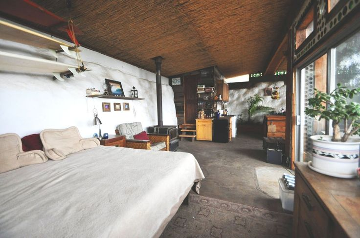 """This Sustainable """"Earthship"""" Home Cost Less Than $10k to Build"""