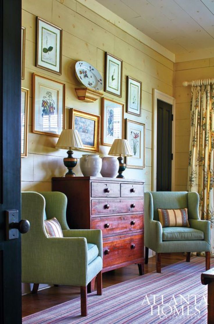 French country living room with buttery yellow ship lap walls, sage and a gallery wall.