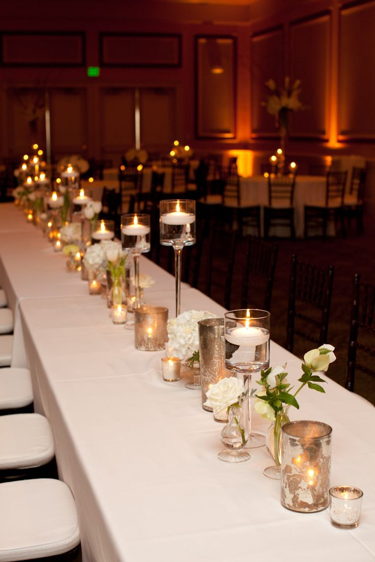 Head Table - would have the bridesmaids flowers and mercury glass votives and could add the taller stemmed candle holders