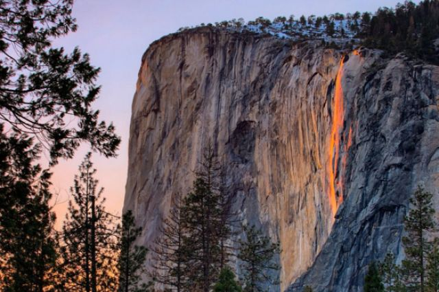 Yosemite National Park's Horsetail Fallflows with spring water from winter until spring. However, during certain evenings in February–if the conditions are just right–the Horsetail Fall appears to glow an orangey-red like a lava fall.