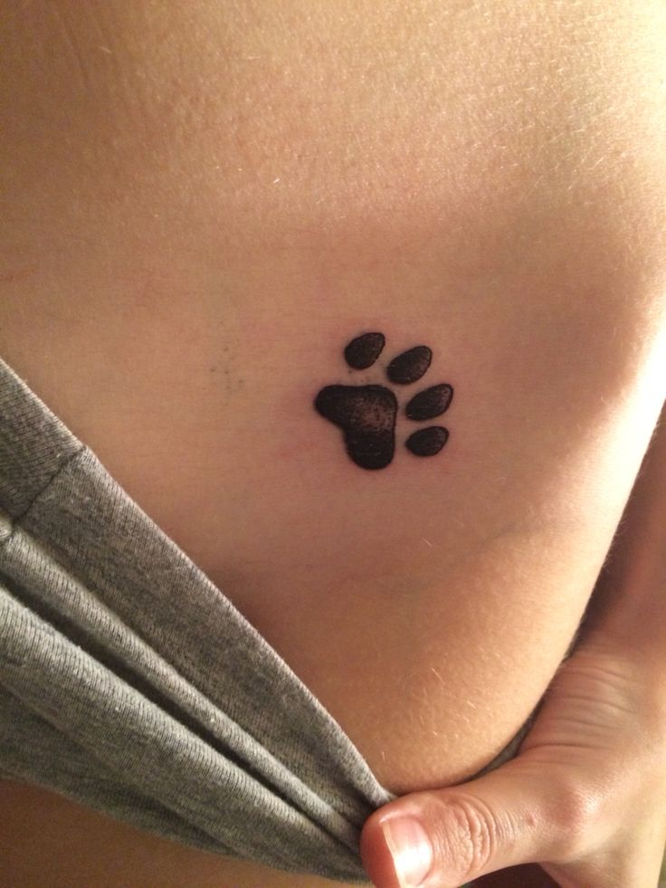 Freshly done paw print on left hip, very happy