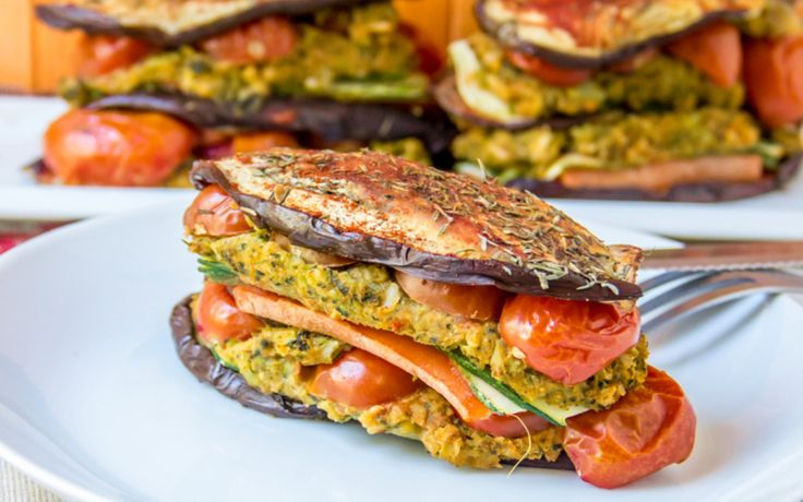 These veggie stuffed rice and hummus stacks are made with eggplant, zucchini, carrots, broccoli, brown rice, cherry tomatoes, and all sorts of other yummy goodies.