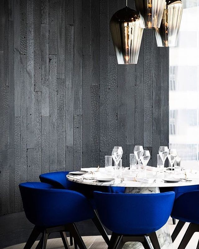 Marble Dining Table With Vibrant Cobalt Blue Chairs