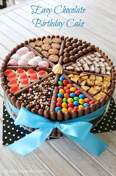 An easy chocolate birthday cake decorated with chocolate biscuits, lollies, marshmallows and chocolates! This really is a chocoholics delight! #chocolate #birthday #cake #easy #baking