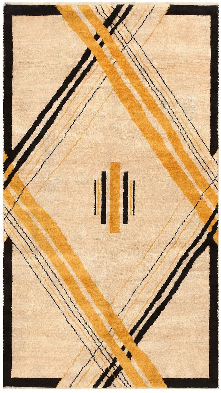 An example of an art deco style rug, featuring the contrasting colours and geometric designs that were common at the time.