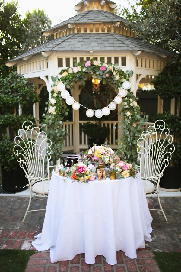 garden reception, photo by Adrienne Gunde http://ruffledblog.com/christmas-house-inn-wedding #weddingideas #backyardwedding
