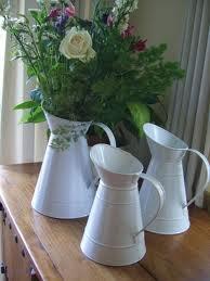 Flowers in old white milk jugs ($9 from ikea)