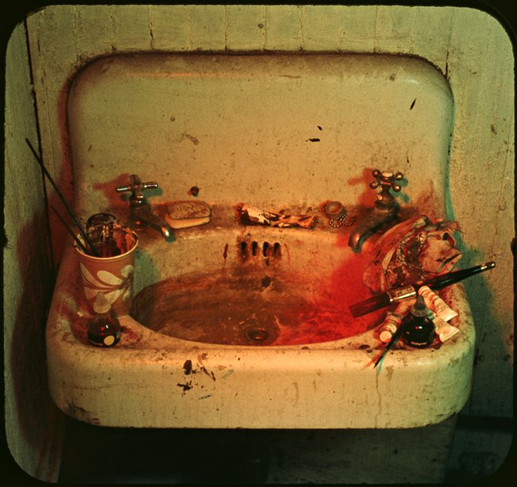 """Interested in re-presentation and repetition, Michael Snow created a series of projected slides of the same studio sink. """"Sink,"""" 1970, Museum of Modern Art."""