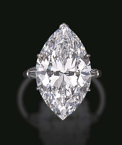 """A HIGHLY IMPORTANT SINGLE-STONE DIAMOND RING, BY HARRY WINSTON  Set with a marquise-cut diamond, weighing approximately 17.80 carats, flanked on either side by tapered baguette-cut diamonds, mounted in platinum, (inscribed """"17.80"""") Signed Winston for Harry Winston"""