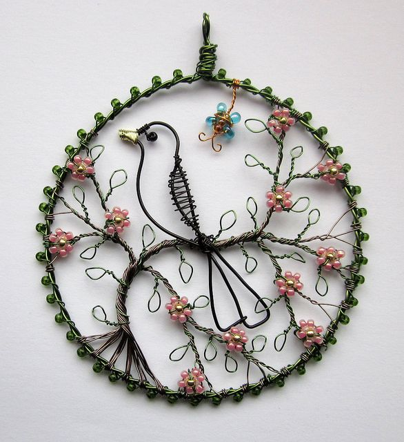 wire bird on a flowering spring branch: