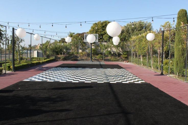 Turning a tennis court into a lighted ballroom is magical and easy. Carpet is 13 x 15 on each side and dance floor is 20 x 20.  No lines will show at all! Dance away...