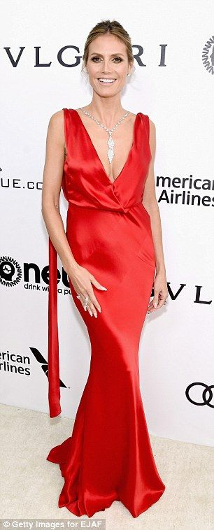 Outfit number 1: The German-American modelstunned in a silk red frock