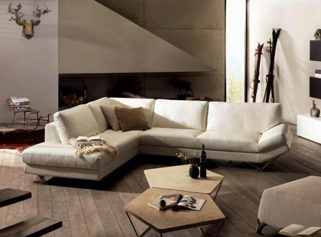 Natuzzi Releve, white sectional. I love the sleek, modern look of this sofa.  The metal legs are really unique and the angled arm makes the whole thing look open and airy.