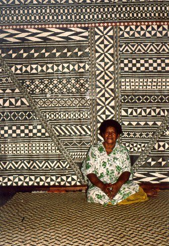 Fine Nailevu with the bark cloth wall decorations made under her supervision in the summer home of the President of Fiji in Somosomo. Symmetries of Culture