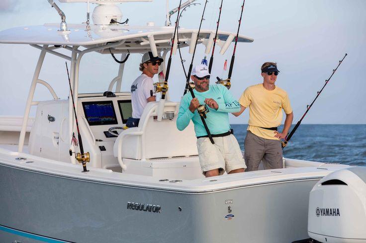 Gray hull Regulator 31 fast fishing boat with white Yamaha