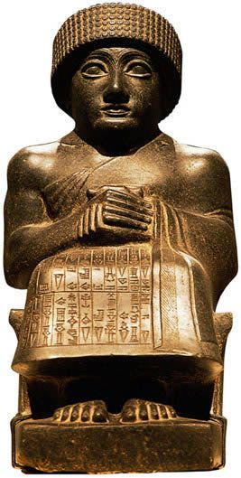 """Girsu. Diorite Statue of Gudea, Prince of Lagash, H. 17-3/8"""", ca 2150–2100 BC. The Akkadian empire collapsed after 200 yrs of rule, & during the next 50 yrs, local kings ruled independent city-states in S Mesop."""