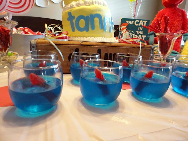 Cat in the Hat Theme - The fish bowls are dollar candle holders from the Dollar Tree. Fill with blue jello and stick in a swedish fish right before the party or the fish will get way smushy.