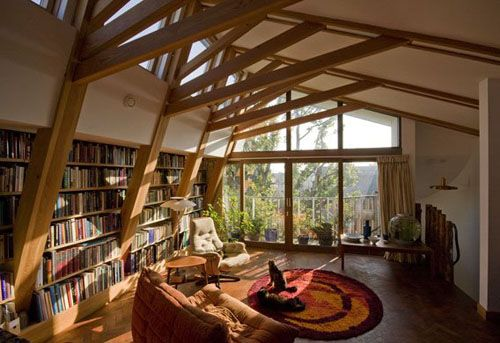 i love the exposed beams along with the book shelves.