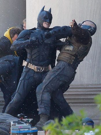 Batman elbows villian Bane, played by Tom Hardy during the filming of the new Batman: Dark Knight Rises