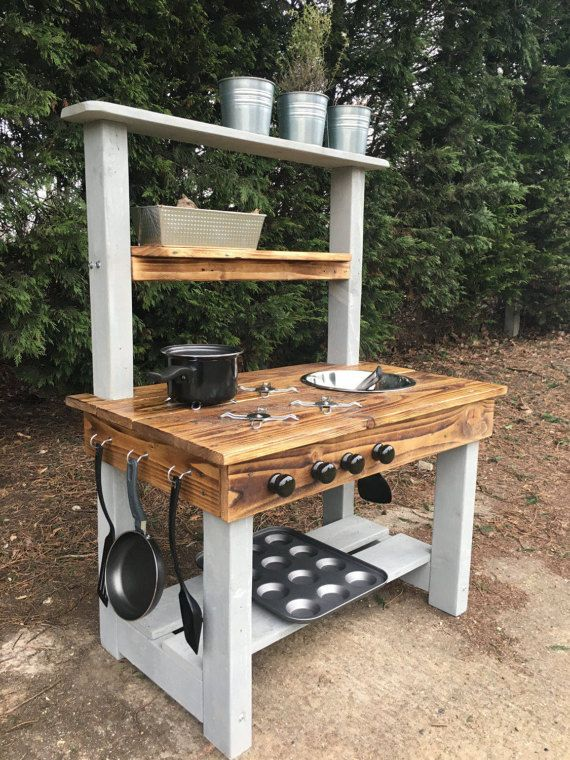 mud kitchen made from recycled wood frame made from pressure treated timber