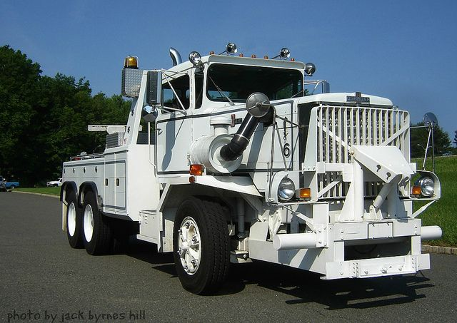1972 Oshkosh 1644 Wrecker with plow mount. Imagine plowing snow with this thing!