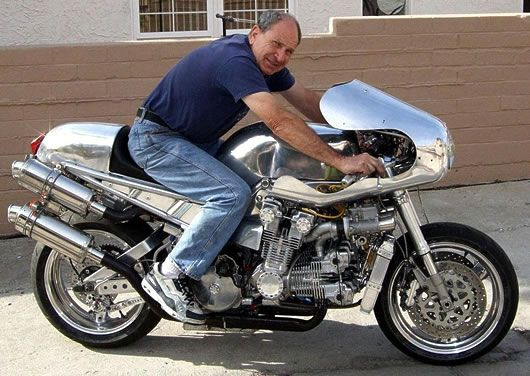 Here is what great Back-Yard Kings can achieve on their OWN, no factory, no big budget, all in a tin shed. Andreas Georgeades and his Honda CBX V12 built from grafting 2 Honda 1000cc 6 cyl engines together. Read his story, its great.
