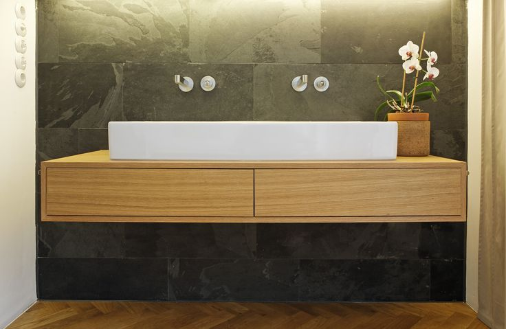 Plan W | Adds width to a tiny and narrow bathroom and balances out the angles. Simple and beautiful bathroom solution!