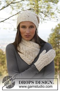"""Knitted DROPS hat, neck warmer and mittens with lace pattern in """"Nepal"""". ~ DROPS Design"""