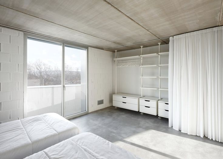 IKEA STOLMEN open wardrobe system with white curtain cover; grey polished concrete floor